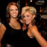 Women smiling in downtown Boise bar