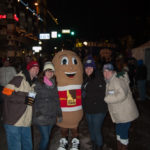 Group Huddles around Potato Mascot