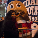 Girl Hugging Idaho Potato mascot