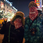 Young couple keeping warm on 8th Street
