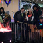 Group of People staying warm at the Idaho Potato Drop