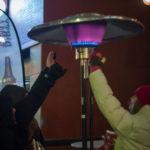 Girls staying warm at the Idaho Potato Drop 2015