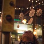Woman looking up at the Idaho Potato Drop
